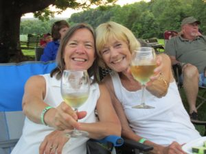 Two friends toasting the sunset at Hickory Hill Winery.