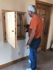 Wrestling with the second floor unit and installing the door.