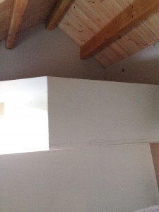 Drywall up in the flying room.